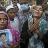 Bangladeshi relatives of missing workers react as they wait at the site of a building that collapsed Wednesday in Savar, near Dhaka, Bangladesh, Friday, April 26, 2013. By Friday, the death toll reached at least 270 people as rescuers continued to search for injured and missing, after a huge section of an eight-story building that housed several garment factories splintered into a pile of concrete.(AP Photo/Kevin Frayer)
