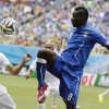 Photo - FILE- In this file photo dated  Tuesday, June 24, 2014, Italy's Mario Balotelli, right, kicks the ball over Uruguay's Martin Caceres during the group D World Cup soccer match between Italy and Uruguay at the Arena das Dunas in Natal, Brazil. England's Liverpool soccer club announced Monday Aug. 25, 2014, it has completed the signing of Italy striker Mario Balotelli from AC Milan. (AP Photo/Ricardo Mazalan, FILE)