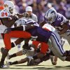 Oklahoma State\'s Kendall Hunter (24) tries to escape the Kansas State defense during the second half of the college football game between the Oklahoma State University Cowboys (OSU) and the Kansas State University Wildcats (KSU) on Saturday, Oct. 30, 2010, in Manhattan, Kan. Photo by Chris Landsberger, The Oklahoman