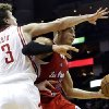 Los Angeles Clippers\' Blake Griffin (32) is fouled by Houston Rockets\' Omer Asik (3) during the first half of an NBA basketball game, Tuesday, Jan. 15, 2013, in Houston. (AP Photo/David J. Phillip)