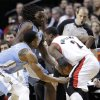 Portland Trail Blazers guard Wesley Matthews (2) is double-teamed by Denver Nuggets\' Andre Iguodala, left, and Kenneth Faried during the first quarter of an NBA basketball game in Portland, Ore., Wednesday, Feb. 27, 2013. (AP Photo/Don Ryan)