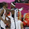 United States\' Kevin Durant, left, and LeBron James celebrate during the men\'s gold medal basketball game against Spain at the 2012 Summer Olympics, Sunday, Aug. 12, 2012, in London. United States won the game 107-100. (AP Photo/Matt Slocum)