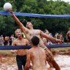 Dustin Boswell tips the ball over the net during the twelfth annual MUDD Volleyball tournament to benefit the Muscular Dystrophy Association, in Mustang, Okla., Saturday, July 20, 2013. Photo by Nate Billings, The Oklahoman