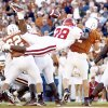 Photo - OU COLLEGE FOOTBALL: OU's Roy Williams knocks the ball loose from Texas QB Chris Simms and sets up an OU interception and TD in the 4th qtr.  University of Oklahoma vs. University of Texas, October 6, 2001, in the Cotton Bowl in Dallas. Photo by Paul Hellstern