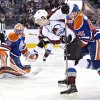Photo - Colorado Avalanche's Nathan MacKinnon (29) and Edmonton Oilers' Martin Marincin (85) battle for the rebound as goalie Ben Scrivens (30) makes the save during first period NHL hockey action in Edmonton,  Alberta, on Tuesday April 8, 2014. (AP Photo/The Canadian Press, Jason Franson)