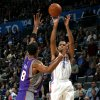 Oklahoma City\'s Thabo Sefolosha (2) shoots over Phoenix\'s Channing Frye during the NBA basketball game between the Oklahoma City Thunder and the Phoenix Suns, Sunday, Dec. 19, 2010, at the Oklahoma City Arena. Photo by Sarah Phipps, The Oklahoman
