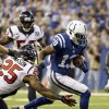 Houston Texans\' Kareem Jackson (25) tackles Indianapolis Colts\' T.Y. Hilton (13) during the first half of an NFL football game, Sunday, Dec. 30, 2012, in Indianapolis. (AP Photo/Michael Conroy)