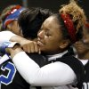 Moore player Sable Hankins is in tears as she hugs Brianna McArthur (12) after their 3-1 loss to as Southmoore in the State 6A Softball Championship game on Saturday, Oct. 19, 2013 in Shawnee, Okla. Photo by Steve Sisney, The Oklahoman