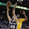 San Antonio Spurs\' Nando De Colo (25) lays up a shot against Golden State Warriors\' Carl Landry during the first half of an NBA basketball game Friday, Feb. 22, 2013, in Oakland, Calif. (AP Photo/Ben Margot)