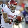 Oklahoma Sooners\' Kenny Stills (4) makes a catch in front of Kansas State Wildcats\' Nigel Malone (24) during the college football game between the University of Oklahoma Sooners (OU) and the Kansas State University Wildcats (KSU) at Bill Snyder Family Stadium on Saturday, Oct. 29, 2011. in Manhattan, Kan. Photo by Chris Landsberger, The Oklahoman ORG XMIT: KOD