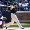 Photo - San Diego Padres' Everth Cabrera, right, follows through on a single during the third inning of a baseball game against the New York Mets, Saturday, June 14, 2014, in New York. (AP Photo/Jason DeCrow)