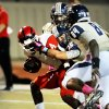 Southmoore\'s Corey Keys (35) draws a facemask penalty while tackling Michael Warren (4) as the Southmoore Sabercats play the Lawton High School Wolverines in high school football on Friday, Oct. 11, 2013, in Moore, Okla. Photo by Steve Sisney, The Oklahoman