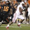 Stanford runningback Jeremy Stewart, right, sprints for the end zone for a touchdown as Oklahoma State cornerback Drake Smithton, left, pursues during the first half of the Fiesta Bowl NCAA college football game Monday, Jan. 2, 2012, in Glendale, Ariz. (AP Photo/Paul Connors)