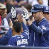 Photo - San Diego Padres' Seth Smith high-fives teammates after his solo home run against the New York Mets in the sixth inning of a baseball game Saturday, July 19, 2014, in San Diego. (AP Photo/Lenny Ignelzi)