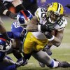 Green Bay Packers running back Alex Green (20) is tackled by New York Giants\' Michael Boley (59) and Mathias Kiwanuka (94) during the first half of an NFL football game, Sunday, Nov. 25, 2012, in East Rutherford, N.J. (AP Photo/Kathy Willens)