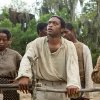"Photo - This image released by Fox Searchlight shows Chiwetel Ejiofor, center, in a scene from ""12 Years A Slave."" The Golden Globes nominations will be announced on Thursday, Dec. 12. (AP Photo/Fox Searchlight, Jaap Buitendijk)"