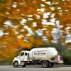 Photo - In this Thursday, Oct. 24, 2013 photo, a propane delivery truck travels through Falmouth, Maine. As the leaves fall and the temperatures drop, a growing number of Mainers will be heating with propane. The fuel is cheaper than oil and can result saving homeowners hundreds of dollars per year. (AP Photo/Robert F. Bukaty)