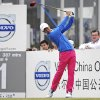 12-year-old Chinese amateur golfer Ye Wocheng watches his tee shot on the second day of the Volvo China Open at the Tianjin Binhai Lake Golf Club in north China\'s Tianjin Municipality Friday, May 3, 2013. Ye became the youngest player ever to compete in a European Tour event. (AP Photo) CHINA OUT