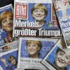 The photo shows photos of German Chancellor Angela Merkel on the front pages of German newspapers in Berlin Monday, Sept. 23, 2013, the day after Merkel\'s Christian Democrats triumphed in Germany\'s election. The headlines read