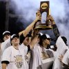 Vanderbilt players hold up the trophy after Vanderbilt defeated Virginia 3-2 in the deciding game of the best-of-three NCAA baseball College World Series finals in Omaha, Neb., Wednesday, June 25, 2014. (AP Photo/Eric Francis)