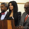 Photo -   FILE - In this April, 11, 2012, file photo former Miss USA Rima Fakih, center, stands before the court with city attorney Todd Russell Perkins, left, and her attorney Otis Culpepper, for her drunken driving case in Highland Park, Mich. Fakih, the first Arab-American to be crowned Miss USA, was sentenced Wednesday, May 9, 2012, to probation and community service. The judge put her on six months' probation, ordered 20 hours of community service and said she must pay fines and costs. (AP Photo/The Detroit News, Charles V. Tines, File) DETROIT FREE PRESS OUT; HUFFINGTON POST OUT; MAGS OUT; NO ARCHIVE; MANDATORY CREDIT