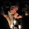 Robert Marriott, father of Lizzi Marriott, is consoled during an emotional candlelight vigil on Saturday night, Oct. 13, 2012, at the Bay State Commons, for his daughter, Elizabeth