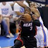 Miami\'s Dwyane Wade (3) goes past Oklahoma City\'s Russell Westbrook (0) during Game 2 of the NBA Finals between the Oklahoma City Thunder and the Miami Heat at Chesapeake Energy Arena in Oklahoma City, Thursday, June 14, 2012. Photo by Chris Landsberger, The Oklahoman