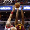 Photo - Cleveland Cavaliers center Andrew Bynum (21) shoots over Washington Wizards center Marcin Gortat (4), from Poland, in the first half of an NBA basketball game on Saturday, Nov. 16, 2013, in Washington. (AP Photo/Alex Brandon)