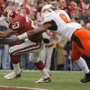 Oklahoma\'s Allen Patrick (23) scores a touchdown past Oklahoma State\'s Donovan Woods (8) during the first half of the college football game between the University of Oklahoma Sooners (OU) and the Oklahoma State University Cowboys (OSU) at the Gaylord Family-Memorial Stadium on Saturday, Nov. 24, 2007, in Norman, Okla. Photo By NATE BILLINGS, The Oklahoman