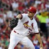 Photo - St. Louis Cardinals' starting pitcher Tyler Lyons throws against the Chicago Cubs in the first inning in a baseball game, Monday, May 12, 2014, at Busch Stadium in St. Louis. (AP Photo/Bill Boyce)