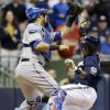Texas Rangers catcher Geovany Soto tags out Milwaukee Brewers\' Jean Segura at home during the third inning of a baseball game Wednesday, May 8, 2013, in Milwaukee. Segura tried to score from second on a hit by Aramis Ramirez. (AP Photo/Morry Gash)