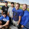 Noble football assistant coaches Matt Lane, seated, Kyle Davidson, left, and Tyler Solomon, second from left, along with running back Jimmy Wood and head coach Steve Barrett, right, pose for a photo at the Noble High School football field in Noble, Okla., Wednesday, Oct. 31, 2012. Photo by Nate Billings, The Oklahoman