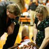 OSU\'s Andrea Riley is attended to by head coach Kurt Budke, left, and trainer Amy Shipman in the second half during the women\'s college basketball game between Oklahoma State University and Baylor University at Gallagher-Iba Arena in Stillwater, Okla., Tuesday, February 5, 2008. BY MATT STRASEN, THE OKLAHOMAN