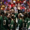 The USF Bulls celebrate during a Women\'s College World Series game between Louisiana State University and the University of South Florida at ASA Hall of Fame Stadium in Oklahoma City, Saturday, June 2, 2012. Photo by Garett Fisbeck, The Oklahoman