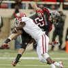 Oklahoma\'s Gabe Lynn (9) brings down Texas Tech\'s Jace Amaro (22) during a college football game between the University of Oklahoma (OU) and Texas Tech University at Jones AT&T Stadium in Lubbock, Texas, Saturday, Oct. 6, 2012. Oklahoma won 41-20. Photo by Bryan Terry, The Oklahoman