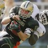Oklahoma State\'s Calvin Barnett (99) drops Baylor\'s Nick Florence (11) for a loss during a college football game between the Oklahoma State University Cowboys (OSU) and the Baylor University Bears at Floyd Casey Stadium in Waco, Texas, Saturday, Dec. 1, 2012. Photo by Nate Billings, The Oklahoman