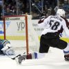 Photo - Colorado Avalanche's Patrick Bordeleau (58) scores past San Jose Sharks goalie Alex Stalock, left, during the second period of an NHL hockey game Friday, April 11, 2014, in San Jose, Calif. (AP Photo/Marcio Jose Sanchez)