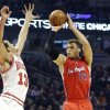 Photo - Los Angeles Clippers forward Blake Griffin (32) shoots over Chicago Bulls center Joakim Noah during the first half of an NBA basketball game, Tuesday, Dec. 11, 2012, in Chicago. (AP Photo/Charles Rex Arbogast)