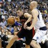 Toronto Raptors\' Jonas Valanciunas (17), of Lithuania, drives to the basket against Dallas Mavericks\' Chris Kaman, right, in the first half of an NBA basketball game, Wednesday, Nov. 7, 2012, in Dallas. (AP Photo/Tony Gutierrez)