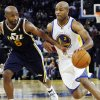 Golden State Warriors\' Jarrett Jack (2) drives for the basket as Utah Jazz\'s Jamaal Tinsley (6) defends during the first half of a preseason NBA basketball game in Oakland, Calif., Monday, Oct. 8, 2012. (AP Photo/George Nikitin)