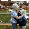 Photo - Jerry Dirks, at right, hugs her friend Earlene Langley after a tornado hit Driks' home just south of Carney Okla., on Sunday, May 19, 2013. Dirks was in her cellar at the time the tornado hit. (AP Photo/The Oklahoman, Bryan Terry)