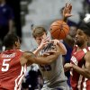 Photo - Kansas State's Will Spradling, center, passes the ball away under pressure from Oklahoma's Je'lon Hornbeak (5) and Cameron Clark, right, during the first half of an NCAA college basketball game Tuesday, Jan. 14, 2014, in Manhattan, Kan. (AP Photo/Charlie Riedel)