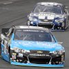 Photo - Dale Earnhardt Jr., leads Jimmie Johnson during practice for Sunday's NASCAR Sprint Cup series auto race at New Hampshire Motor Speedway, Saturday, Sept. 21, 2013, in Loudon, N.H. (AP Photo/Jim Cole)