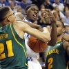 Kentucky\'s Alex Poythress, middle is wrapped up between Baylor\'s Isaiah Austin (21) and Rico Gathers (2) during the first half of an NCAA college basketball game at Rupp Arena in Lexington, Ky., Saturday, Dec. 1, 2012. (AP Photo/James Crisp)