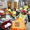 Volunteers stuff bags in preparation for Haunt the Zoo at the Oklahoma City Zoo. The five-day event starts Friday. Photo by Paul Hellstern, The Oklahoman PAUL HELLSTERN