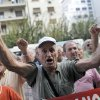 A pensioner shouts slogans during an anti-austerity protest in front of the EU headquarters in Athens on Monday, Oct. 8, 2012. The 17 eurozone ministers will look Monday at Greece\'s budget proposals. They will hear from the troika — the European Commission, the European Central Bank and the International Monetary Fund — about its negotiations with the Greek government. No final troika report will be submitted, so no decision on a new payout of aid will be made.(AP Photo)