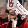 Jessica Santiago, El Paso, mother of OU band member Stephanie Santiago, talks on her phone near the ticket booth before the college football game between the University of Oklahoma Sooners (OU) and the Stanford University Cardinal on Thursday, Dec. 31, 2009, in El Paso, Tex. Photo by Steve Sisney, The Oklahoman