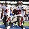 Photo -   Tampa Bay Buccaneers running back Doug Martin (22) celebrates with Erik Lorig (41) after rushing for a touchdown during the first half of an NFL football game against the New York Giants, Sunday, Sept. 16, 2012, in East Rutherford, N.J. (AP Photo/Julio Cortez)