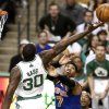 Boston Celtics\' Brandon Bass (30) tries to get a rebound over New York Knicks\' Carmelo Anthony during the second quarter of Game 3 of a first-round NBA basketball playoff series in Boston, Friday, April 26, 2013. (AP Photo/Winslow Townson)