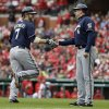 Milwaukee Brewers\' Mark Reynolds, left, is congratulated by third base coach Ed Sedar while rounding the bases after hitting a two-run home run during the second inning of a baseball game against the St. Louis Cardinals Wednesday, April 30, 2014, in St. Louis. (AP Photo/Jeff Roberson)